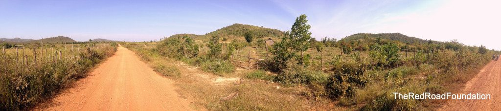 This picture shows the neighboring property, owned by the village chief. He is currently growing mango and banana trees on the plot. Our prospect for the project site starts on the right hand side of the picture where the bikes can be seen and stretches up the line of trees you can follow t o the base of the mountain.