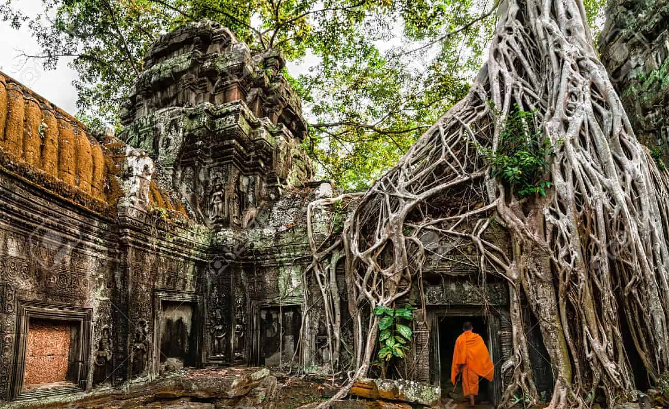 29657363-buddhist-monk-at-angkor-wat-ancient-khmer-architecture-ta-prohm-temple-ruins-hidden-in-jungles-popul