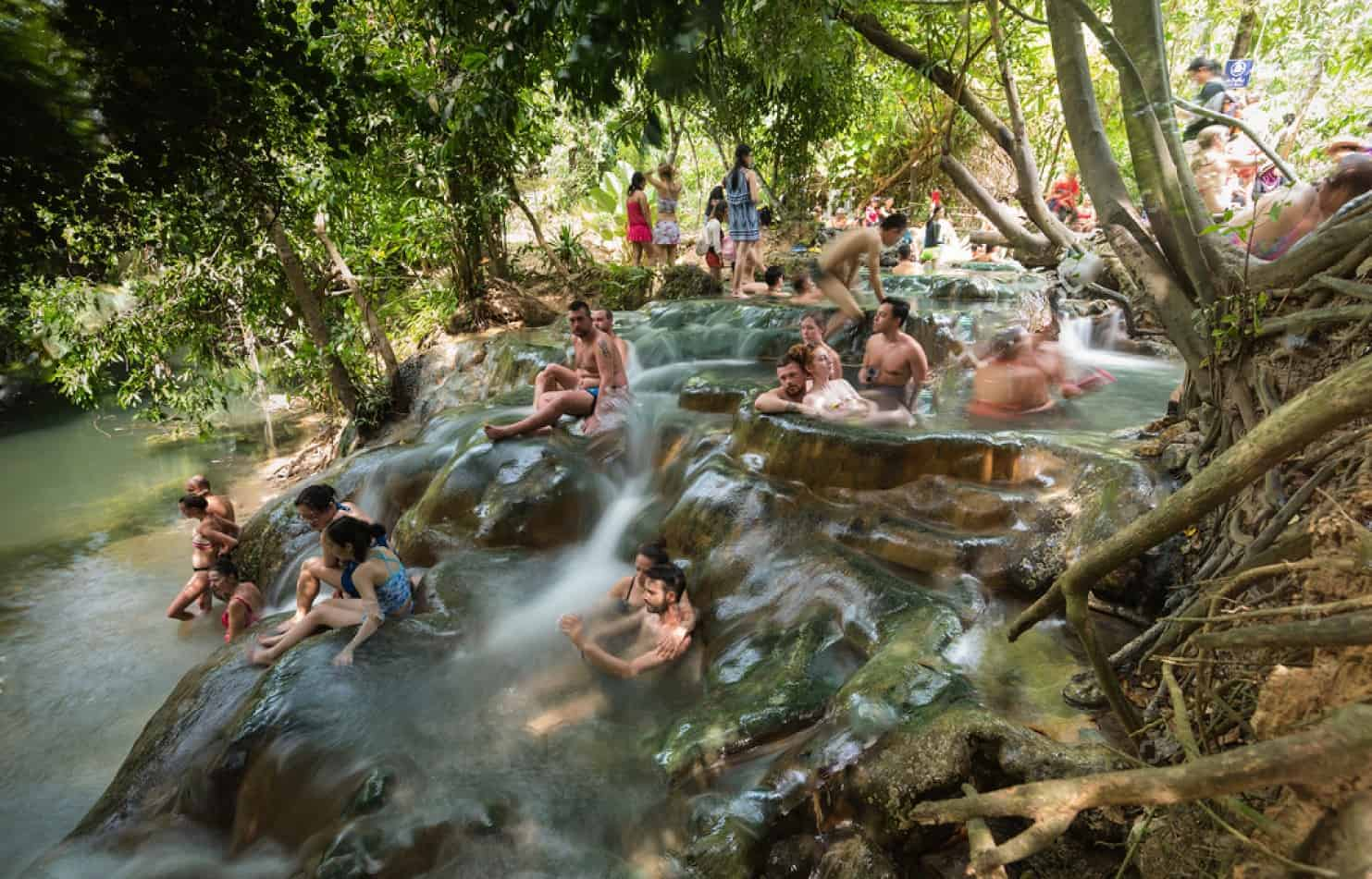 stock-photo-krabi-thailand-mar-people-soak-and-relax-in-hot-mineral-waterfall-famous-place-in-385605037